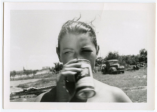 Vintage photography of woman drinking beer