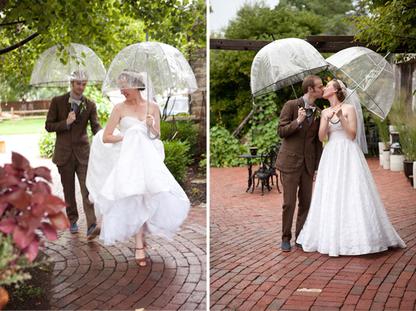 newlyweds kissing and running through the rain with vintage umbrellas