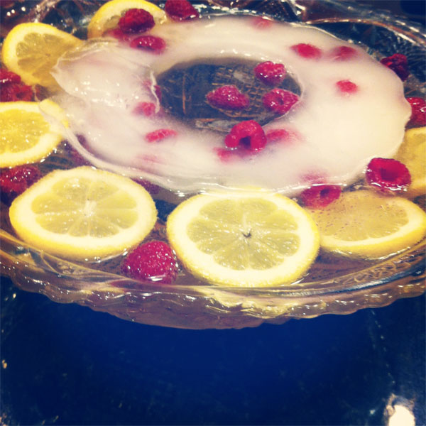 french holiday punch with lemon and raspberries