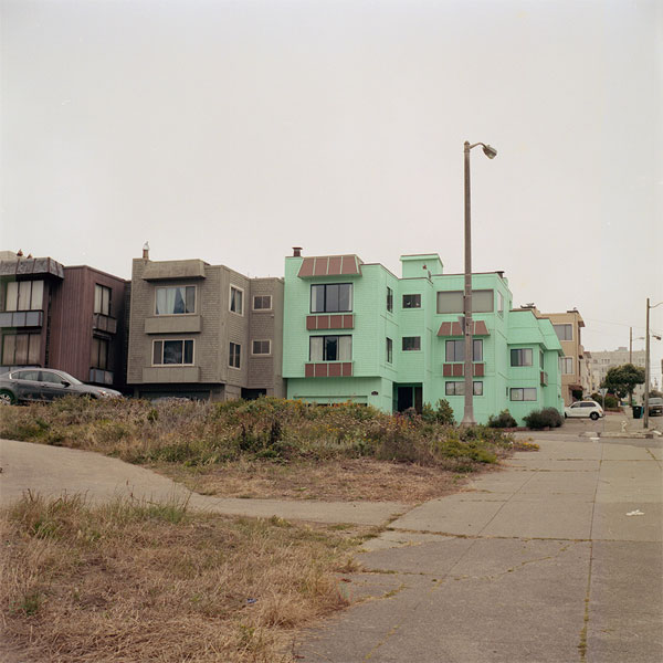 photograph of a mint green building by Michael ten Pas
