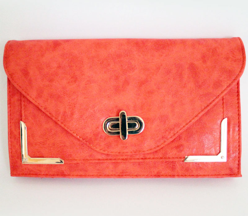 giveaway: tangerine tango clutch from MickeysGirl.com