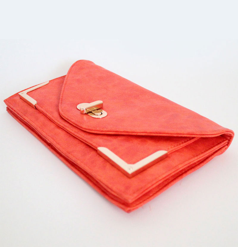 giveaway: tangerine and gold clutch