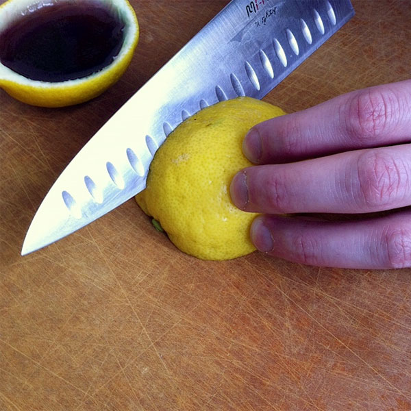 slicing margarita jello shot lemon wedges
