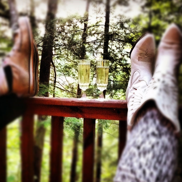 champagne and cowgirl boots in the Smoky Mountains in Tennessee