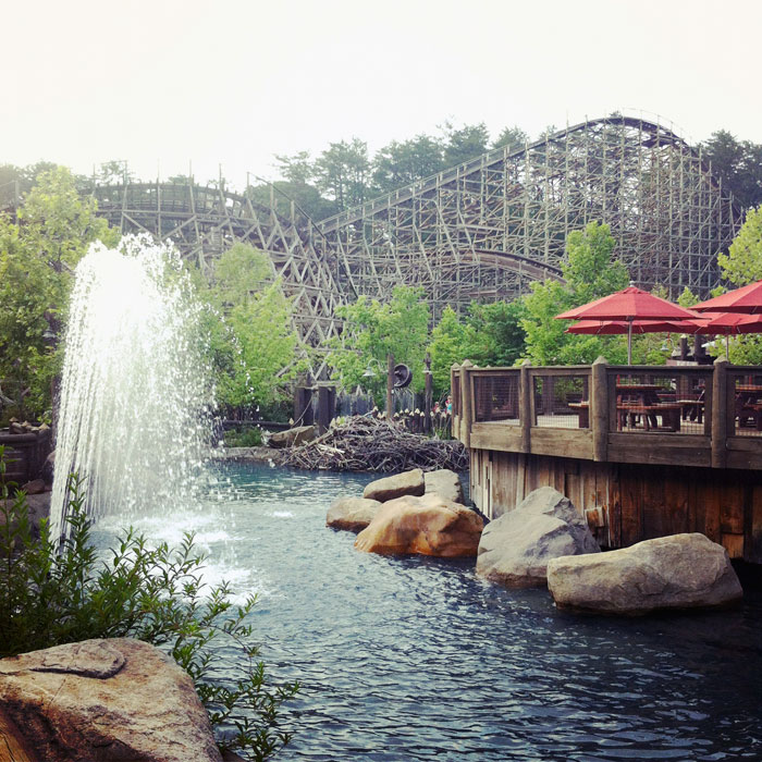 wooden roller coaster and pond fountain at Dollywood