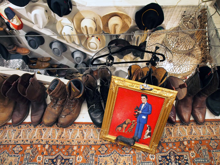vintage Elvis painting, cowboy hats, and boots at Savant Vintage in Nashville, TN