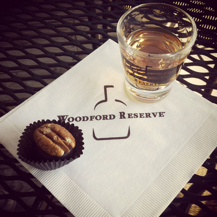 free chocolate bourbon ball and shot of Woodford Reserve bourbon