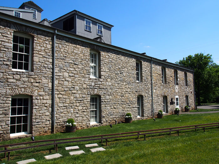 Woodford Reserve limestone building and bourbon barrel tracks