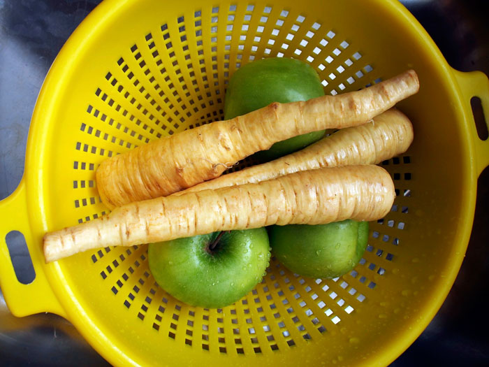 freshly washed apples and parsnips