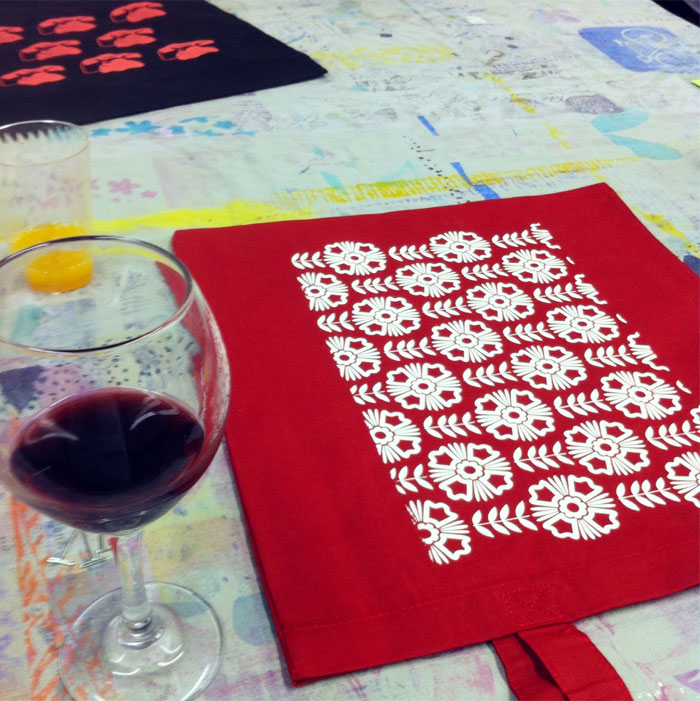 red wine and a handmade screenprint tote bag