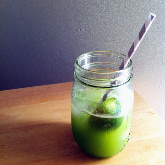 a glass of fresh juice (honeydew, apples, cabbage, lime)