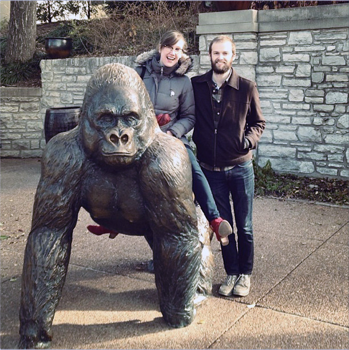 Sarah West Ervin and Brian West on a gorilla sculpture at the St. Louis Zoo