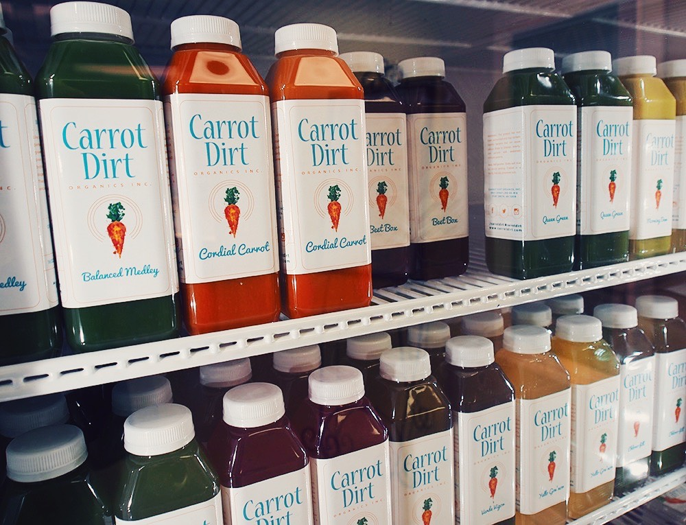 bottles of freshly made, cold-press juice from Carrot Dirt Organics, Inc.