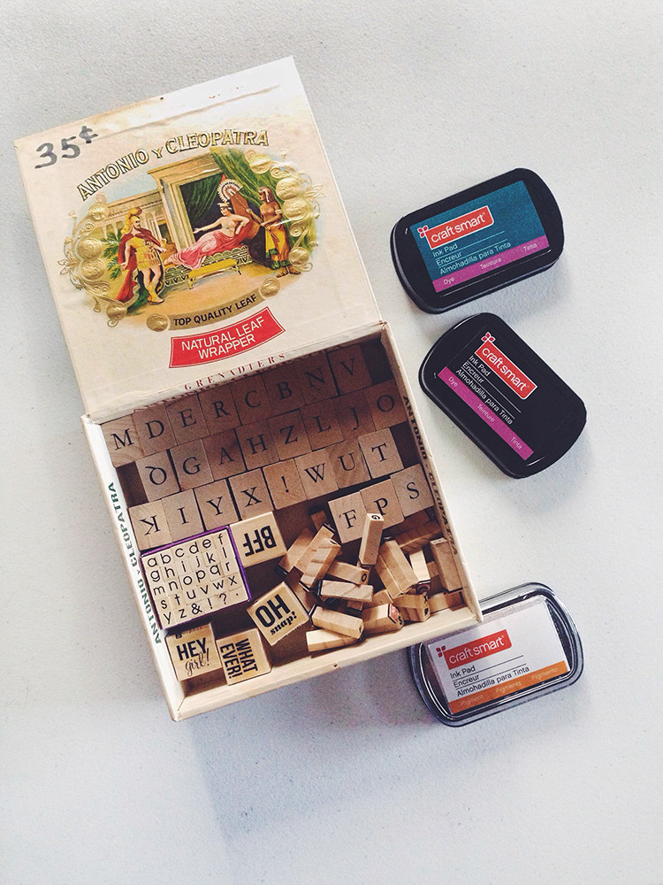 alphabet stamps and ink in a vintage cigar box